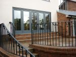 202 - Bifolding door opening onto a patio area
