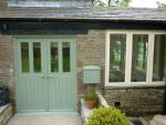 187 - Double doors in a slate green colour combining slim glazed units and boarded base