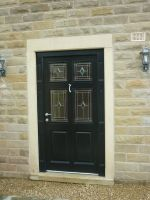 155 - Front door with a combination of stained glass units and panelled timber base